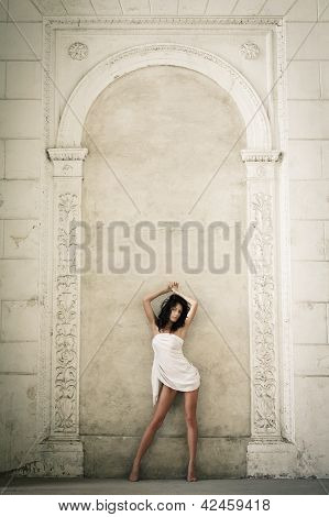 Beautiful Young Woman Posing In A Castle Interior