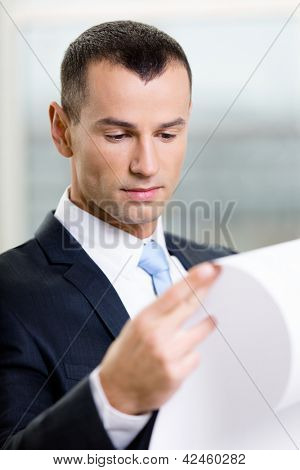 Close up of businessman with draft. Concept of successful construction