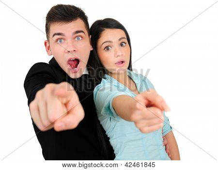 Isolated young business couple pointing