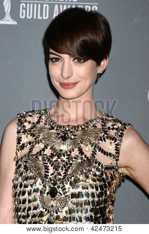 LOS ANGELES - FEB 19:  Anne Hathaway arrives at the 15th Annual Costume Designers Guild Awards at the Beverly HIlton Hotel on February 19, 2013 in Beverly Hills, CA