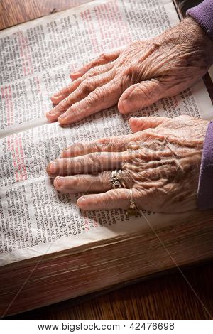 Elder Woman's Hands On Bible