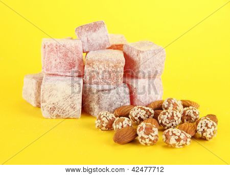 rahat lokum and nuts on yellow background