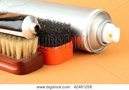 Set of stuff for cleaning and polish shoes, on color background