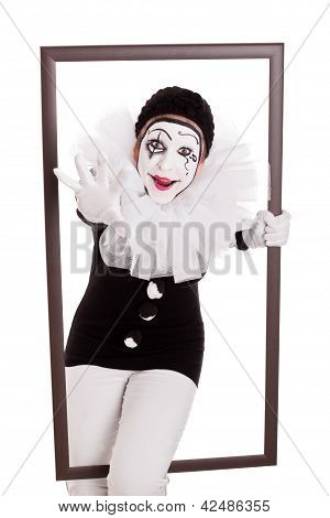 Female Pierrot In A Frame Reaching Hand To Viewer