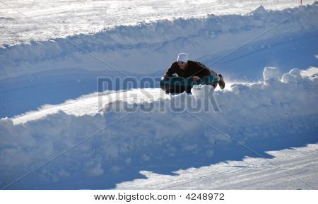 Man Tubing Down The Hill