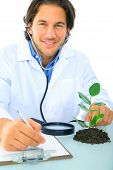 Happy Young Caucasian Scientist Analyze Plant