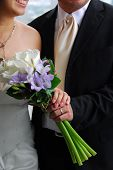 Wedding - Focus On Couple, Holding Hands Together With Bouquet Of Flowers