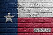 image of texans  - Brick wall with a painting of a flag isolated Texas - JPG