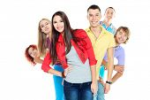 stock photo of united we stand  - Large group of young people standing together in a row - JPG