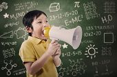 pic of einstein  - Boy student is announcing something using speaker in a classroom - JPG