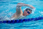 pic of breath taking  - Swimmer Taking a Quick Breath Doing Freestyle  - JPG