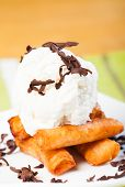 image of lumpia  - fried custard wrapped lumpia wrapper topped with vanilla ice cream and shaved truffle chocolates - JPG