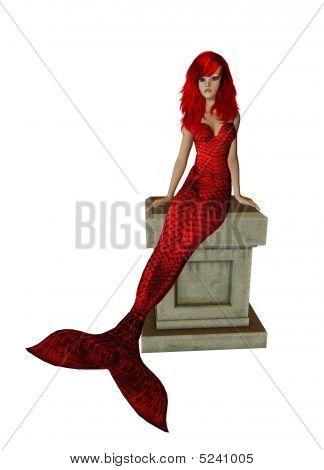 Red Mermaid Sitting On A Pedestal