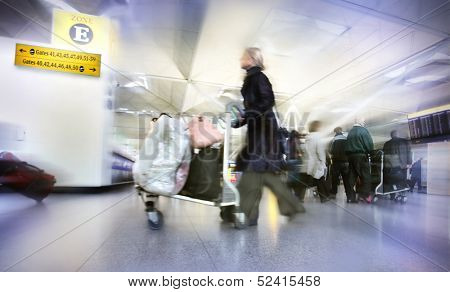 Women with bags at the airport, motion blur