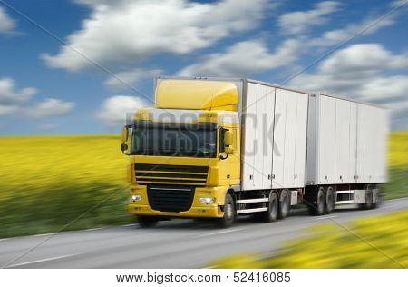 truck driving on country-road/motin blur