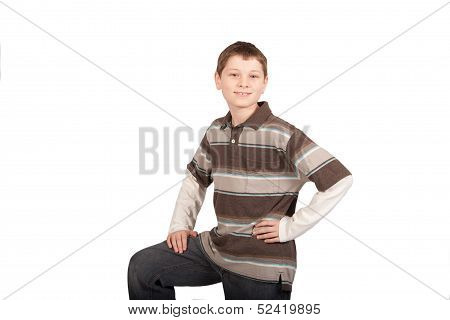 Smiling Boy With Hand On Hip