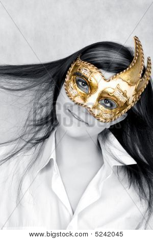 Pretty Young Woman in Venetian golden Mask