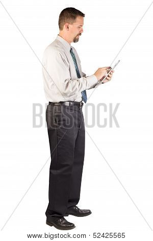 Corporate Man Standing While Using Tablet
