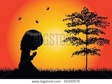 Little girl praying silhouette