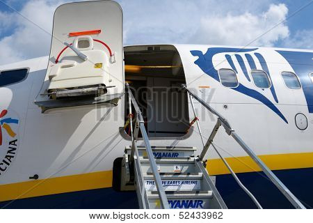 MAASTRICHT, NETHERLANDS - SEPTEMBER 8: Boarding stairs to Ryanair aircraft in Maastricht airport, Netherlands on September 8, 2013. Ryanair will carry 81.5 million passengers this year