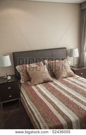 Bright, modern bedroom with striped bedspread.