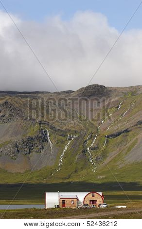 Iceland. Snaefellnes Peninsula. Landscape With Volcanic Mountains, Waterfalls And A House.