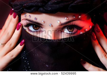 arabian woman close-ups brown eye look.