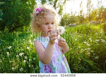 Little girl with dandelion.