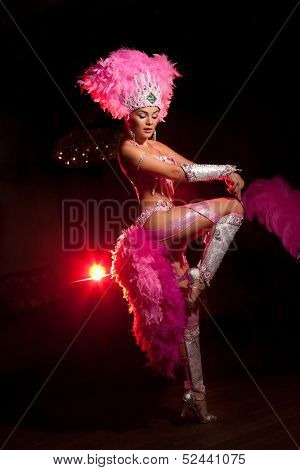 cabaret dancer over dark background