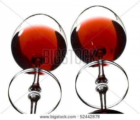 two glasses of wine reflected in mirror