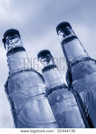 three bottle with water drops