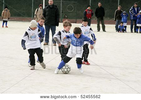 Children Playing Soccer In Winter At An Outdoor Arena