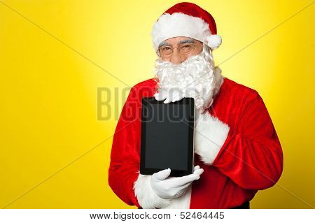 Santa Claus Holding Newly Launched Tablet Device