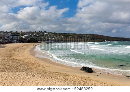 Porthmeor beach St Ives Cornwall England with white waves breaking towards the shore