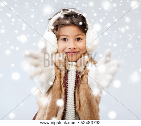 winter, people, happiness concept - happy little girl in winter clothes