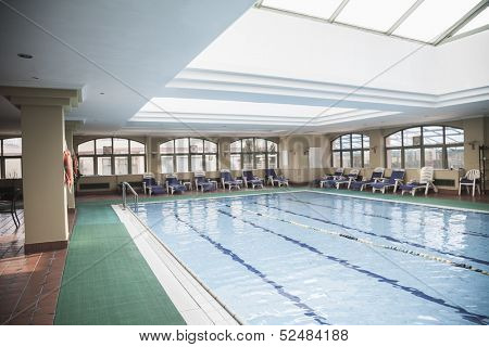 Large, indoor swimming pool with skylight.