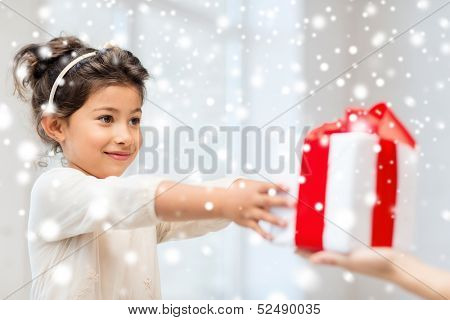holidays, presents, christmas, x-mas, birthday concept - happy child girl with gift box