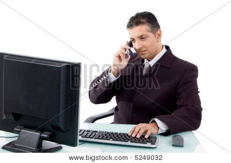 Side View Of Businessman Busy On Phone