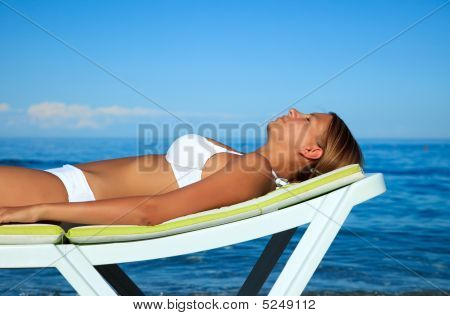 Young Girl Is Taking A Sun Bath