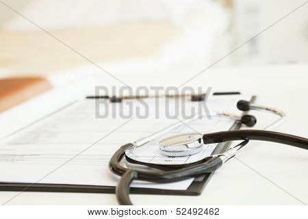 Close-Up of stethoscope and medical chart