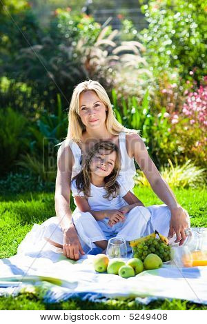 Mother And Daughter Enjoying A Picnic