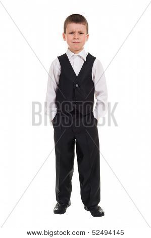 serious boy in suit on white
