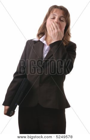 Tired Business Woman In Suit With Computer