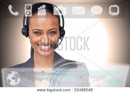 Beautiful smiling businesswoman using futuristic interface showing applications looking at camera