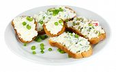 stock photo of hardtack  - Sandwiches with cottage cheese and greens on plate isolated on white - JPG