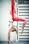 stock photo of gravity  - Young woman making antigravity yoga exercises - JPG