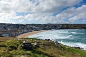 pic of st ives  - Porthmeor beach St Ives Cornwall England by the Tate Art Gallery with white waves crashing towards the shore and known for surfing - JPG