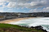 pic of st ives  - Porthmeor beach St Ives Cornwall England with white waves breaking towards the shore and known for surfing - JPG