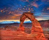 stock photo of cloud formation  - Arches National Park Delicate Arch sunset in Moab Utah USA photo mount - JPG