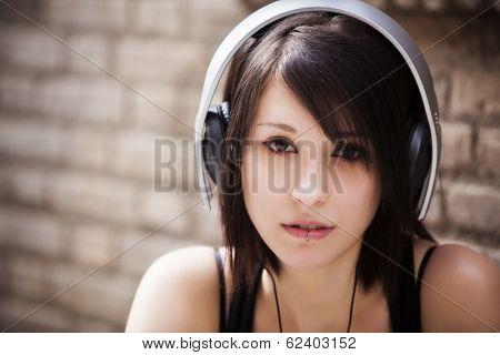 Young beautiful girl portrait wearing headphones.